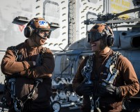PACIFIC OCEAN (Dec. 3, 2016) Seaman George Sablan, left, and Seaman Abraham Alvarez, both assigned to the Gray Wolves of Electronic Attack Squadron (VAQ) 142 stand on the flight deck of the aircraft carrier USS Nimitz (CVN 68). Nimitz is currently underway conducting Tailored Ship's Training Availability and Final Evaluation Problem (TSTA/FEP), which evaluates the crew on their performance during training drills and real-world scenarios. Once Nimitz completes TSTA/FEP they will begin Board of Inspection and Survey (INSURV) and Composite Training Unit Exercise (COMPTUEX) in preparation for an upcoming 2017 deployment. (U.S. Navy photo by Petty Officer 2nd Class Siobhana R. McEwen/Released)